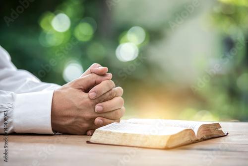 Fotografie, Obraz  A man reading the Holy Bible.