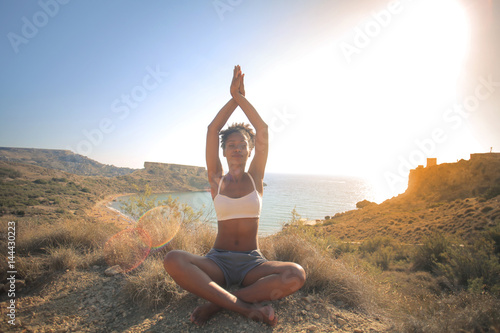 Doing yoga on a cliff