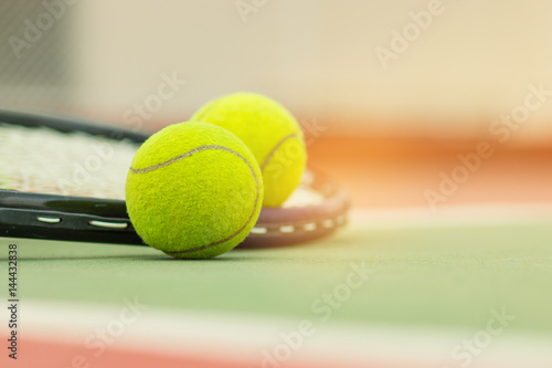 Tennis Ball with Racket on the racket in tennis court
