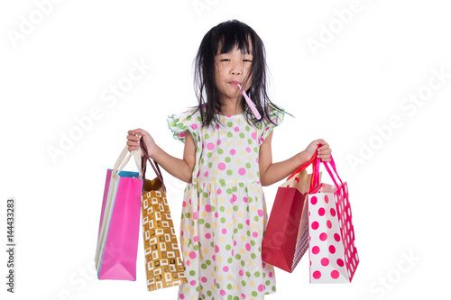 Asian chinese little girl with shopping bags Canvas Print
