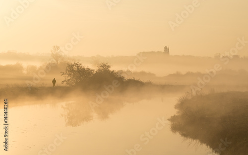 Printed kitchen splashbacks River Man walking along banks of river on misty morning