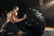 Cross Strongman Training - Man Flipping Tire