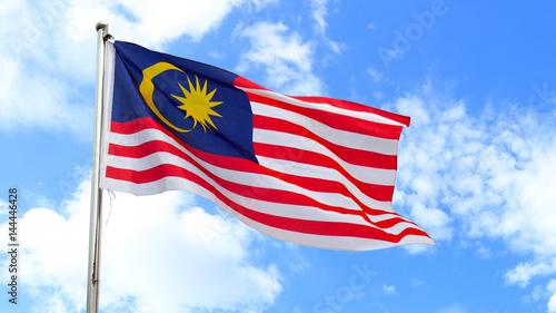 Fotografía  Malaysian national flag on a pole against bright blue sky.