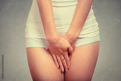 Valokuva woman with hands over her crotch. Health hygiene concept
