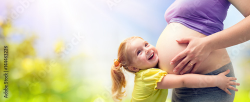 Obraz Happy Sister Hugging Pregnant Mother