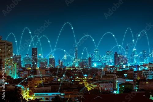 Zdjęcie XXL abstrakcyjne połączenie linii na tle miasta w nocy