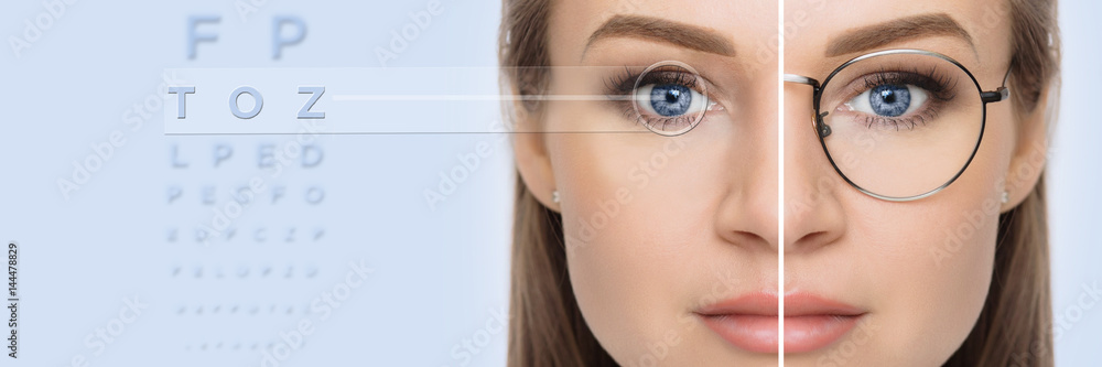 Fototapeta female face, cut in half to present before and after laser vision correction. Woman face with glasses and without glasses, on background virtual holographic eye chart. vision correction technology