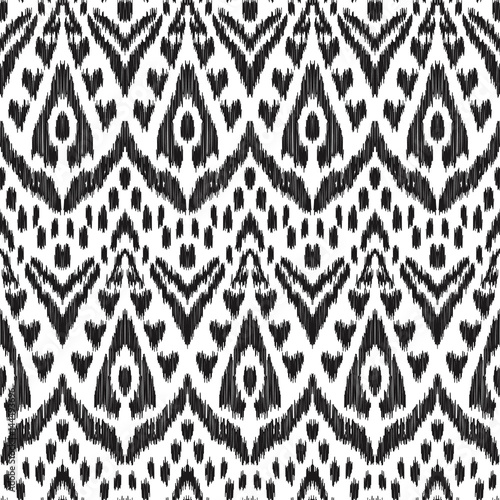 In de dag Boho Stijl Vector illustration of black and white colored Ikat seamless pattern. Creative hippies print. Stylish ethnic backdrop. Scribble effect.