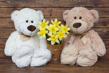 Two Teddy Bears With A Bouquet