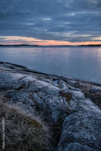 Blue hour dusk over Stockholm archipelago nature landscape in Sweden with rocks Wallpaper Mural