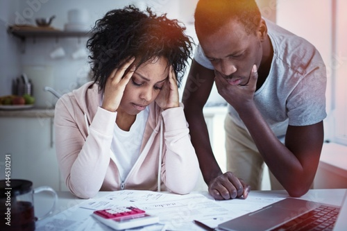 Fotografia, Obraz  Young stressed african american couple in trouble, have no money to pay debts, to pay rent for appartment