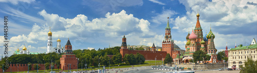 Poster Moskou Panoramic view on Moscow Red Square, Kremlin towers, stars and Clock Kuranti, Saint Basil's Cathedral church Ivan bell tower. Panorama from hotel Russia. Moscow holidays vacation tours Putin residence