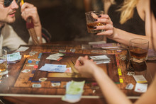 Friends Drinking And Playing Board Game