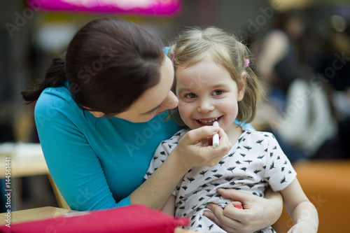 Portrait of a European girl 3-4 years old and mother  A
