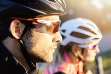 Headshot Of Young Attractive Bearded Caucasian Man Cyclist Taking Part In Bicycle Parade, Selective Focus On His Head In Helmet. Human And Active Leisure. Summer Sports. Healthy Lifestyle Concept