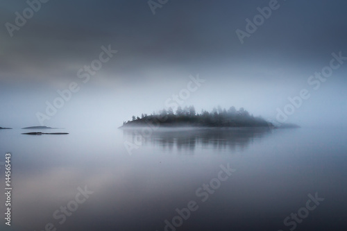 The island is in a fog. Kar...