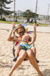 Baby boy with her mom having fun on a swing at the beach. Summertime