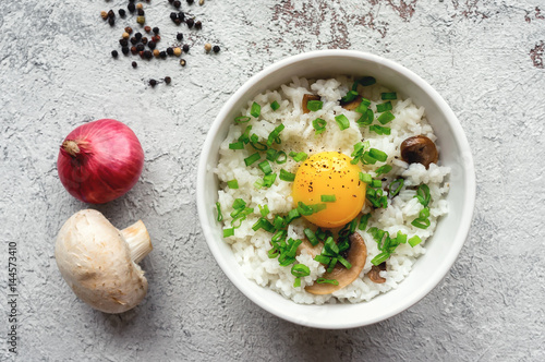Hot white rice with raw yolk, mushroom and green onion Canvas Print