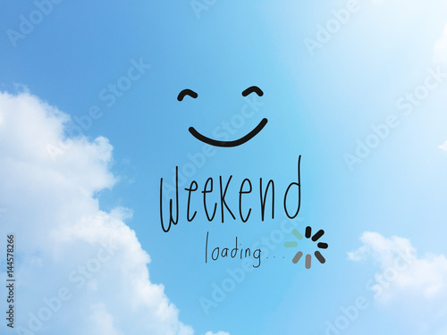 Obraz Weekend loading word and smile face on blue sky - fototapety do salonu