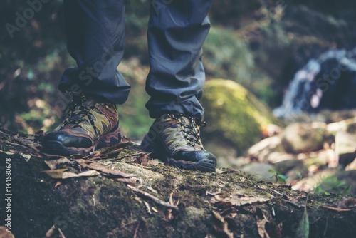 Close Up Of Adventure Man Feet Walk On A Mountain Path