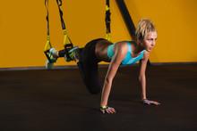 Sporty Woman Doing Pushups Usi...