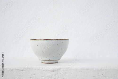 Cuadros en Lienzo white ceramic tea cup with cement wall background