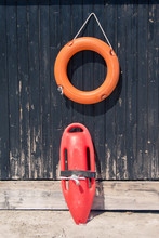 Lifebuoy And Lifeguard Rescue Can Equipment Against The Wooden Tower
