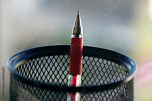 Red pen in penholder Fototapeta