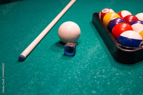 Canvas Print Billiard balls near by cue and chalk