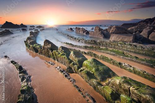 Foto op Aluminium Strand Scenic Sunset at barrika beach, mossy rocks. Bilbao, Basque country, Spain.