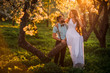 canvas print picture - Beautiful bride and groom at sunset in the Park. A spring wedding.