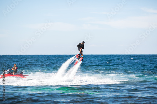 Garden Poster Water Motor sports Silhouette of a fly board rider at sea