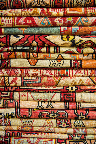 Papiers peints Affiche vintage Bright, colorful Turkish fabrics, bedspreads and kerchiefs with different oriental patterns. The texture of the textile or fabric, macro. Tissue, textile, cloth, material, woven.