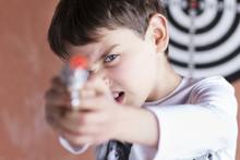 Boy Taking Aim With A Toy Gun
