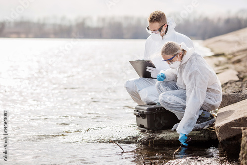 Valokuva Scientists or biologists wearing protective uniforms working together on water analysis