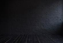 Dark Interior With Black Brick Wall And Black Wooden Floor