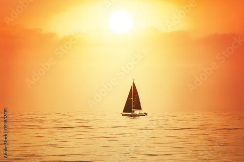 Obrazy na płótnie Canvas Sailboat at sunset