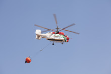 Firefighting Helicopter Carrying A Bucket