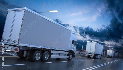 Fototapeta Widok z tyłu kilku samochodów ciężarowych na autostradzie