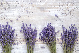 Fototapeta Lavender - laveder composition with dry bouquet rustic background top view space for text