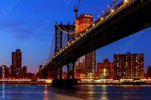Manhattan Bridge illuminated at dusk very long exposure