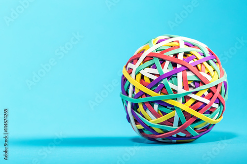 Rubber band ball on blue background Wallpaper Mural