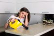 Woman cleaning kitchen with steam cleaner