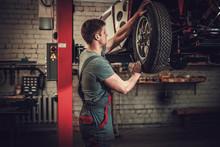 Mechanic Working On Classic Ca...