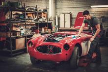 Mechanic Polishning Car In Restoration Workshop