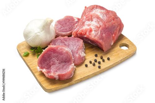 Staande foto Vlees Solomillo de cerdo troceado