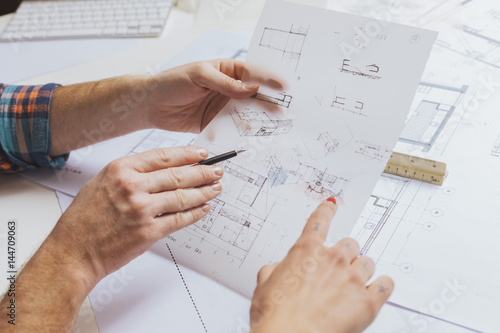 Hands of architects with sketch