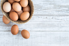 Eggs In A Basket On A White Wo...