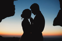 Wedding Couple At Sunset In The Mountains
