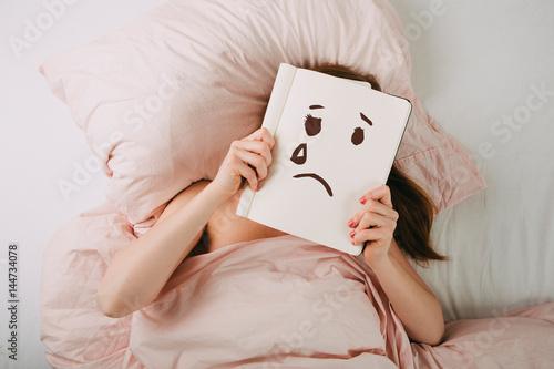 Fotografija  Junge Frau im Bett